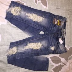 Modern Vintage Boutique Jeans Distressed jeans size 3. I bought these and waited too long to return. Never worn with tags. There is a hole in the top of the back pocket as shown in photo. Jeans Skinny
