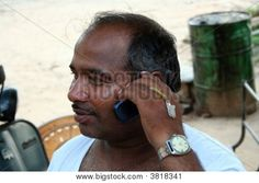 Indian construction site manager on phone