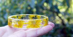 Flowers Frozen In Time Inside Handmade Resin Bracelets by Sarah Smith, the Oregon-based artist behind Modern Flower Child