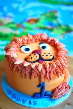 Child's lion birthday cake - carrot cake inside with vanilla buttercream in different colours