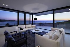 The Lamble Residence, situated on an elevated position on the south coast of New South Whales, Australia, and overlooking the Gerringong beach was designed by Smart Design Studio to...