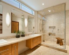 I like the window over the mirrors, the light colors of the bathroom, the tile in the shower with the shelves, and the cabinet style.  Bathroom Design Ideas, Pictures, Remodel and Decor