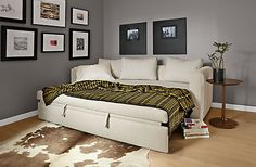 The Oxford Pop-up Platform sleeper sofa has clean, modern styling you'll love in any room. So easy to set up, you'll use it for sleeping, family movie night and more. Simply pull out the bottom deck with the attached tabs and the bed pops right up. Spring and high-resiliency foam create a supportive queen-sized mattress so your guests get a good night's sleep.