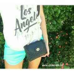 Hang out with the perfect size vegan leather black crossbody purse. Wear it with blue high waisted shorts and a cute loose blush top WWW.LUXEANDVAIN.COM