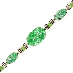 Art Deco gold, carved jade and enamel bracelet, circa 1930. I think this is so pretty and interesting.