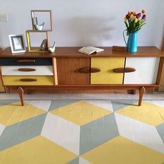 WoW!  1960s retro teak painted sideboard on painted geometric floor! Think we should bring it back??? LOL #TBT #ThrowBackThursday #oldschool