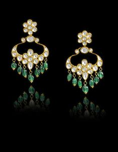 A pair of Indian diamond-set gold pendent Earrings Tika Jewelry, Indian Jewelry Earrings, Royal Jewelry, Emerald Earrings, Diamond Jewelry, Gold Jewelry, Jewelery, Jewelry Bracelets, Gold Pendent