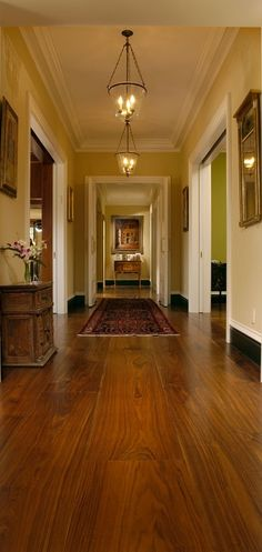 Those baseboards are anchoring this room and the effect is terrific!... really dark baseboard accent