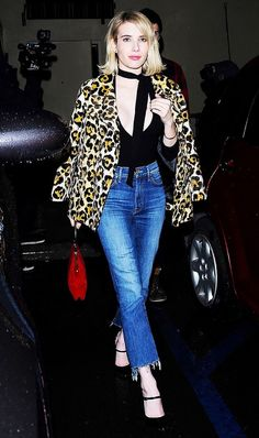 Emma Roberts jazzes up her outfit with an animal print coat.