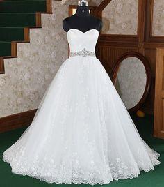 A-line Strapless Scalloped-Edged Neckline Organza weep/Brush Train Wedding Dress. $199.00, via Etsy.