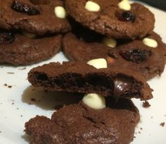 These crispy, chewy, fudgy cookies with four types of chocolate and dried cranberries are a combination of brownies and chocolate cookies rolled into one!