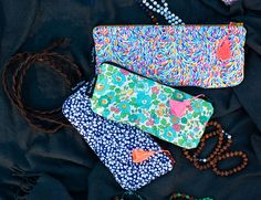 GO SHOP: www.novamelina.com  International shipping!  Liberty pf London fabrics, unique design products, boho scarfs, pouches, lanyards, softies, accessories, all things pretty!  #libertyoflondon #libertyprint #pouch #neon #tassel #unique #handmade #finnish #design