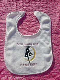 Love this site, has amazing gamer baby stuff :-)      Sailor Moon embroidered Bib by GamerMomCreations on Etsy, $6.20