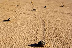 Sailing Stones - These 700+ lb. stones move all over Death Valley in California, without the aid of man nor machine. It was recently discovered that, in the winter months, these big rocks move when layers of water and ice begin to melt under them - sending them on a slow slide to a new, sandy destination.