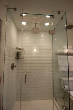 Wihte subway tile surround + penny tiles on floor. Too antiseptic for me.