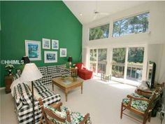 This beautiful home is accented with beautiful blues and greens.     #beach #paint #realestate  www.hhireb.com