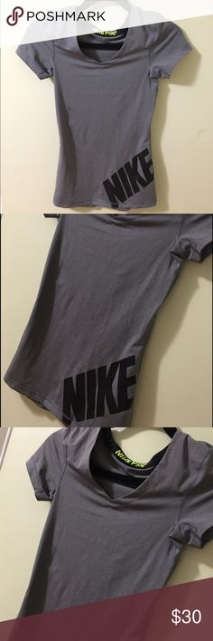 Gray Short Sleeve V-Neck Nike Pro Shirt Gray Short Sleeve V-Neck Nike Pro Shirt. This shirt is a nike pro shirt with short sleeves and a v-neck. This material does not show any sweat and keeps you dry when working out. Nike Tops Tees - Short Sleeve