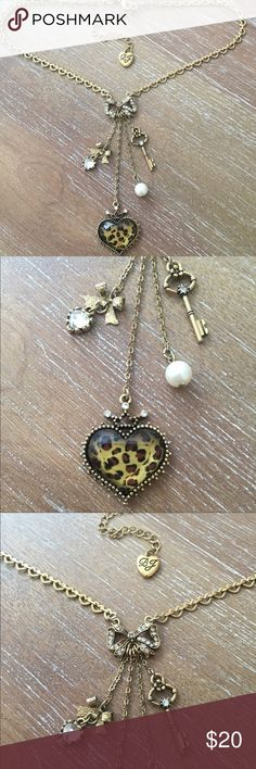 Betsey Johnson Necklace Betsey Johnson necklace with gold heart chain with crystal bow and four dangling charms Betsey Johnson Jewelry Necklaces