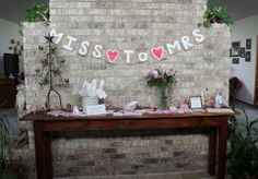 """MISS TO MRS"" banner for Bridal Shower entry table. (I used old Kroger paper sacks, string found in the garage, and regular craft paint.)"