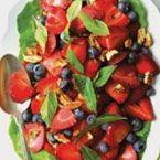 Berry & Basil Salad:  Ingredients:  Makes 8 servings 1/4 cup mild honey (or more, depending on fruit)    1/4 tsp. vanilla extract  2 tbsp. Grand Marnier®  1 tbsp. freshly squeezed lemon juice  4 cups thinly sliced, ripe strawberries  3 cups blueberries, washed and dried  4 cups packed fresh basil, (finely slivered chiffonade style or whole leaf)  1–1/2 cups chopped pecans  1/2 cup full fat yogurt (Greek is the best) or sour cream  Freshly cracked black pepper