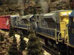 MTH TRAINS:  6  SD-80`s  PULLING A RATHER LONG CONSIST.