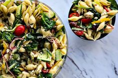 Veggie Lover's Greek Pasta Salad is absolutely bursting with spinach, cucumbers, tomatoes, bell peppers, Greek olives, and red onions.