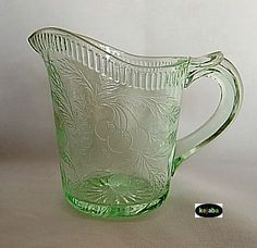 PATTERN NAME: CHERRYBERRY CATAGORY: DEPRESSION MANUFACTURER: U.S. GLASS YEARS MADE: 1928 - 1931 PRIMARY COLORS: Green, Pink OTHER COLORS: Crystal, Iridescent marigold