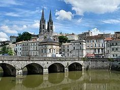A view of Niort from the Sevre Niortaise river, Deux-Sevres, Poitou-Charentes region, France Places Around The World, Around The Worlds, Les Deux Sevres, Poitou Charentes, Ville France, Dordogne, Travel Goals, World Traveler, Places To See