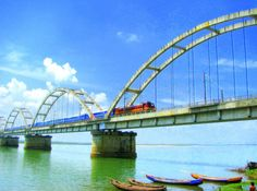 https://flic.kr/p/4CutBJ | Untitled | The Bridge over the Godavari River, Rajahmundry.  Wanted the Sky real blue, ended up saturating the whole picture. :| Nevertheless, I am gonna try to edit it better!