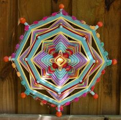 I hope you enjoy this woven 8-sided mandala as much as I enjoyed creating it.    Love these colors!... Orange, purple, yellow and turquoise are the main colors of this 18 mandala. And just for fun its finished off with a row of pom poms.    Mandalas are inspired by many cultures but it was the Huichol Mexican Indians that turned me into a crazy woman scouring the rows of yarn at all the craft shops in town looking for that perfect color combination... I was now able to to combine my mandala…