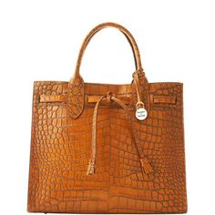 Dooney & Bourke Amazon Tassel Bag $395. love love love...honey my birthday is coming up:) if you get a Yeti I want this!