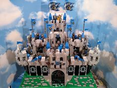 Royal King's Castle - This week's featured MOC is the Royal King's Castle LEGO set, upgraded with BrickWarriors pieces! Put together by one of BrickWarriors' favorite creators, AC Pin, Royal King's Castle shows just your average day at the castle. Up top the King looks out over his castle and kingdom with his trusty wizard friend by his side and his Queen behind him. While the castle below is busy with activity as the knights work to protect the castle. The knights are wearing BrickWarriors…