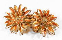 Vintage Retro Coppery Orange and Gold Tone Enamel Flower Clip On Earrings signed Pat. Pending.  Earrings measure 1 1/2 in diameter  Please note that this is vintage, pre-owned jewelry. These earrings have no visible chips and the backs are in excellent condition.  Cleaning vintage jewelry is a personal preference and I leave that up to the buyer.  Age estimate: 1950s-1960s  Vintage costume jewelry brings back so many awesome memories of playing dress-up with my mama and nana . . . their...