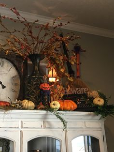 Hutch decorated for Halloween with witches' brooms
