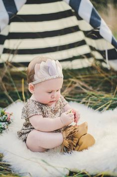 Glamorous adorable hipster baby! Feather crown.