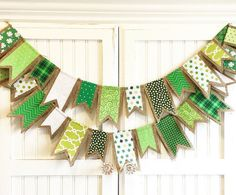 Each flag is made with St. Patricks Day inspired fabric scraps sewn onto natural burlap which are then folded in half and hung over natural jute cord. The