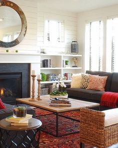 Abby M. Interiors: Modern Bungalow Project: crisp white walls, over dyed rug, mirror over fireplace, small windows on each side of fireplace.