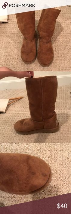UGG Australia sheepskin classic fall boots AN ADORABLE TALL BOOT DESIGNED ESPECIALLY TO KEEP YOUR FEET WARM AND COZY, WHATEVER THE WEATHER. THE SOFT, COZY BOOT IS MADE FROM GENUINE SHEARLING. 2 very small spots on the right boot's toe. UGG Shoes Winter & Rain Boots