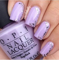 Light purple nails with silver glitter sparkles on the side