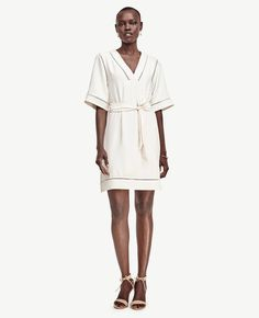 Intricate cutouts, airy sleeves and a prettily draped silhouette make this dress an easy-to-style piece with a casual yet elegant feel. Etched Hem Kimono Dress
