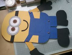 Making a little pin the eyes on the Minion game - could cut parts so kids could make their own minions