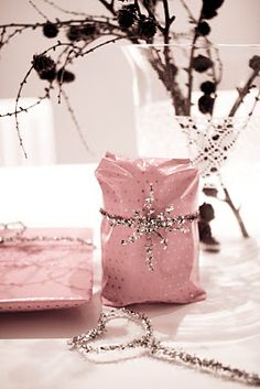 Gift wrapping - silver pipe cleaners add a little glitter to your wrapping.