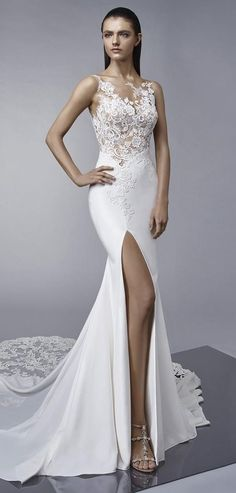 Ooh la la. Feel sultry in this classic, lace and crepe Enzoani 2018 fit-and-flare wedding gown with a twist. Margo features an unlined, illusion lace bodice that blends into the skin and a showstopping skirt side split to show off those legs. Finished with a jaw-dropping lace train, low illusion back, delicate covered buttons and an invisible zipper closure.