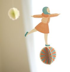 Girl balancing on ball paper mobile. Cute for child's room.