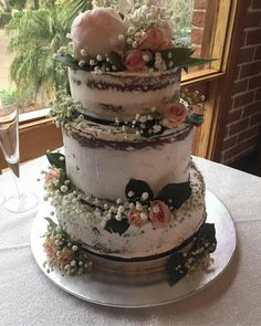 #wedding #married #marriage #weddingcake #cake #white #whitechocolate #nakedcake #nakediced #floral #flowers #elegant #simple #peonies #roses #babysbreath #ribbons #buttercream #icing #celebrate #party #celebration #congratulations