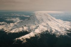 Some Mount Rainier action from the plane [oc] [2048x1367]