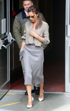 A gray wool skirt topped off Victoria Beckhams look while out at the Vogue Festival.