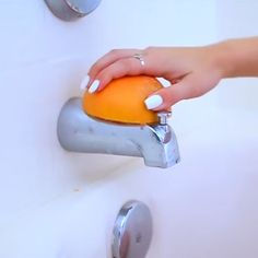 That's right! Cut a grapefruit in half and use it to clean your showerhead and knob. The acid from the fruit gets the job done, plus it leaves a citrusy smell
