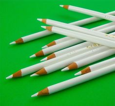 one dozen white pencils
