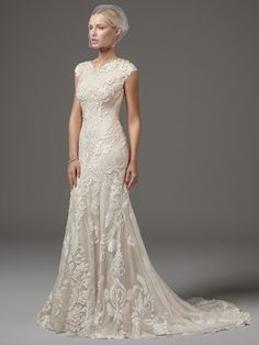 Sottero and Midgley - SUZANNE ROSE, This unique modest wedding dress features laser-cut lace over textured netting and Viva jersey lining in a fit-and-flare silhouette, featuring a jewel neckline and modest cap-sleeves trimmed with lace appliqués. Finished with zipper closure. #modestweddingdress